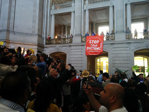 "This ""stop the evictions"" banner was seized by police within minutes of its unfurling, as were the other banners dropped around ""our"" City Hall... go figure!"