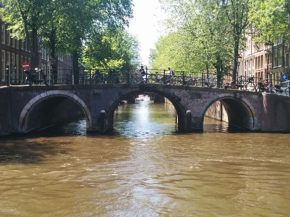 It's no wonder so many of our romanticized utopian fantasies involve canals and bicycles... Amsterdam is in our dreams whether or not we've ever visited!