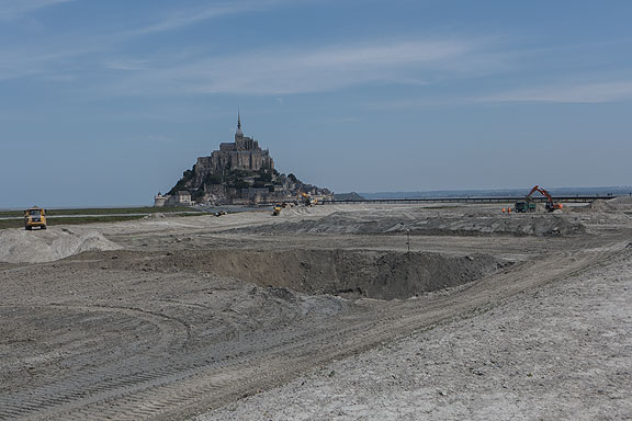 Approaching Mt. St. Michel now is to pass through an epic reorganization of the local tidelands to accommodate the endless flow of tourists.