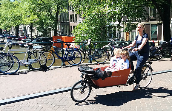 Ubiquitous Dutch cargo bikes, mostly used to schlep kids around...
