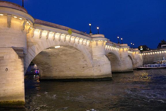 Gliding under a Parisian bridge on the Seine.