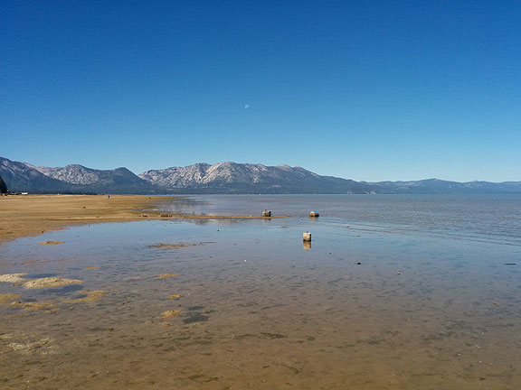 I caught the moon over the western hills along the beach at South Lake Tahoe, rather sad in its depleted state after 3  years of drought.