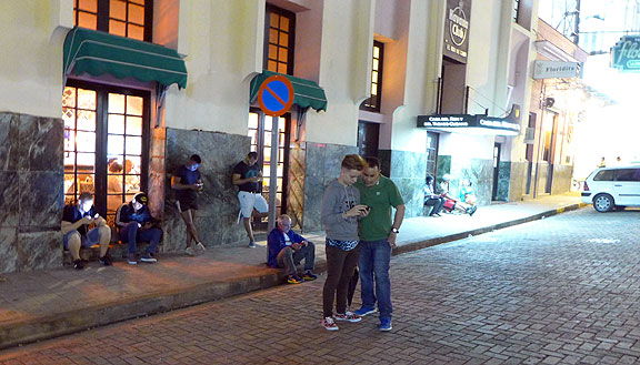Getting a signal outside of Hemingway's storied Floridita Bar in Havana...