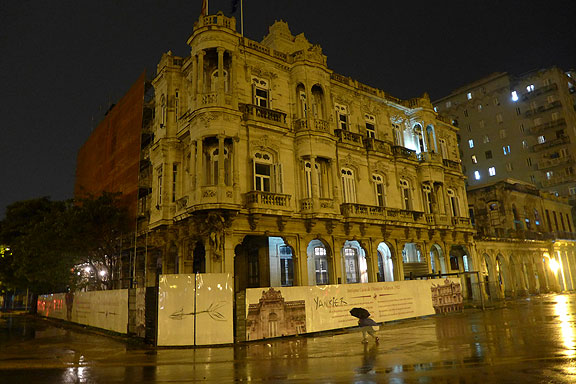 "One of many elegant buildings in Havana being restored, a graffiti tagger hit the sign with the word ""Yankier""..."