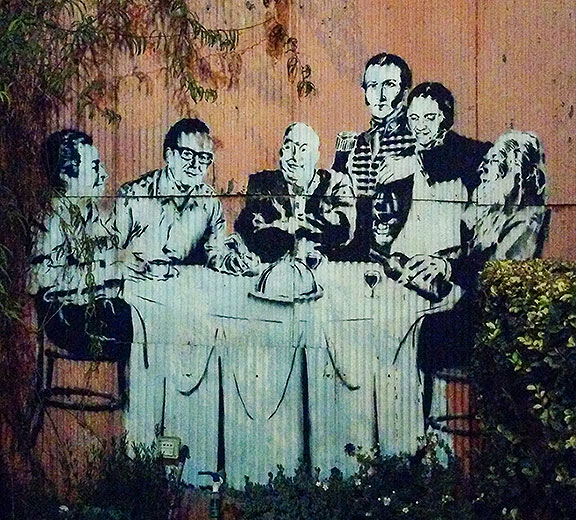 This stencil is at the top of the block with the trees in the street, featuring giants of Chilean culture: (l to r) Gabriela Mistral, Salvador Allende, Pablo Neruda, Manuel Rodriguez, Violeta Parra, and Clotario Blest.