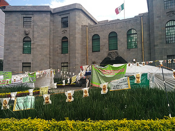 A whole 'nother protest at the Ministry of Health where there are hundreds of poopy diapers hung around the building!